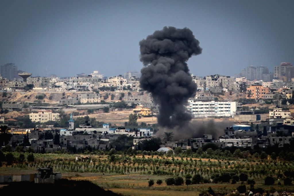 Smoke rises in Gaza strip following an Israeli military strike seen from southern Israel bordering the Gaza Strip, on Aug. 10, 2014. Israeli officials accepted .
