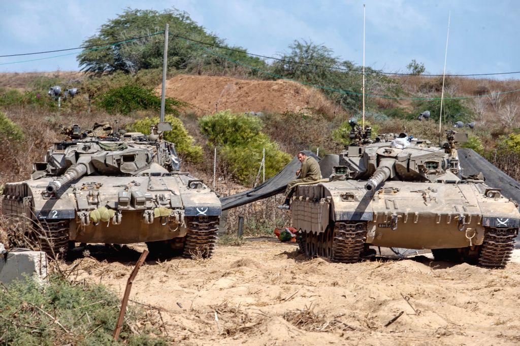 An Israeli soldier sits on a Merkava tank in southern Israel near the border with Gaza, on July 15, 2014. The Israeli army on Tuesday resumed air strikes ...