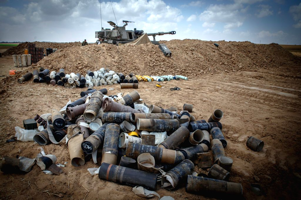 Empty shells are laid on the ground next to an Israeli artillery unit in southern Israel near the border with Gaza, on July 15, 2014. The Israeli army on ...