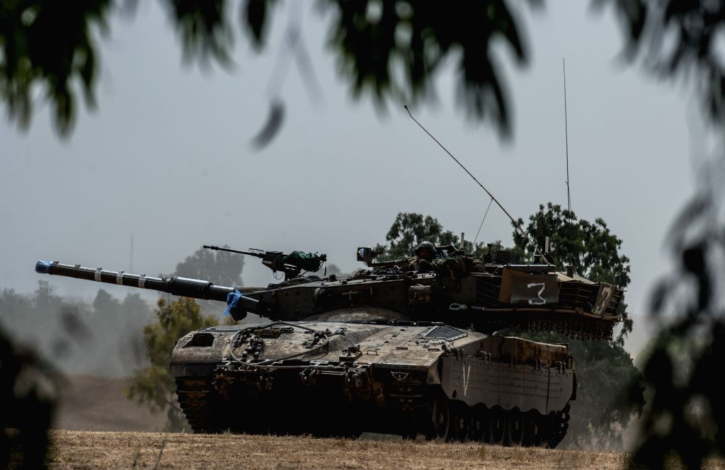 An Israeli Markava tank waits for orders in the field in southern Israel near the border with Gaza, on July 18, 2014, the 11th day of Operation Protective Edge. - Benjamin Netanyahu