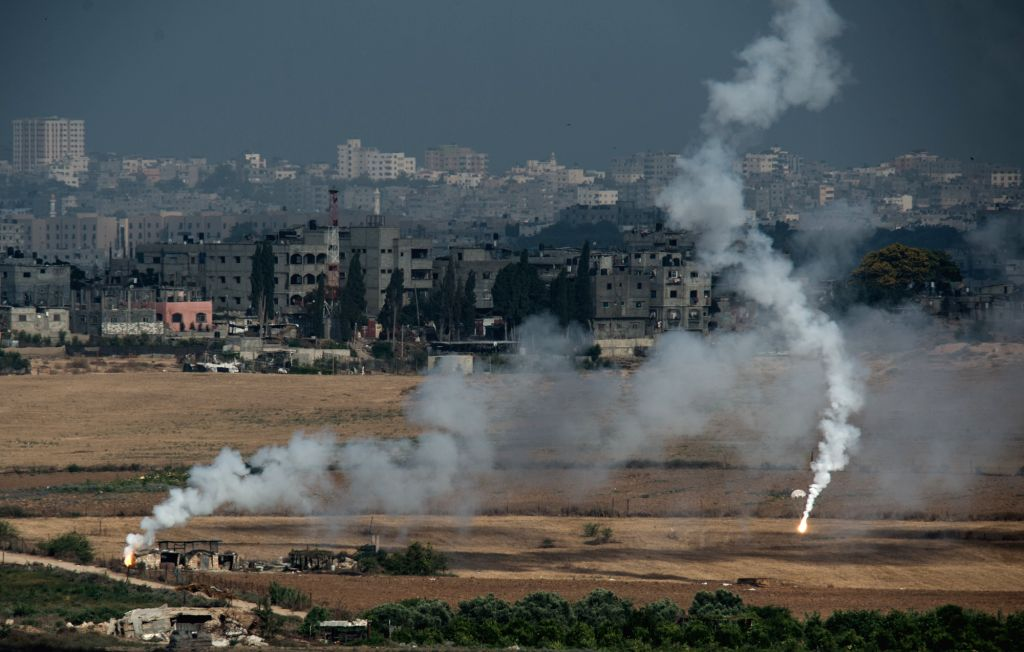 Flares fired by Israeli artilleries landing on northern Gaza Strip are seen from Sderot, an Israeli town near the border with Gaza Strip, on July 18, 2014, the . - Benjamin Netanyahu