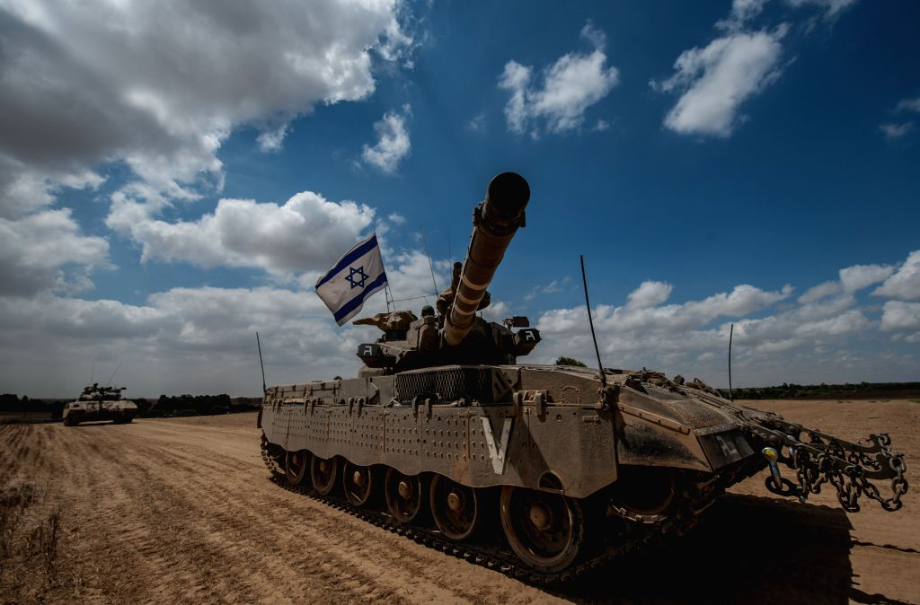 Israeli Markava tanks wait for orders in the field in southern Israel near the border with Gaza, on July 18, 2014, the 11th day of Operation Protective Edge. ... - Benjamin Netanyahu