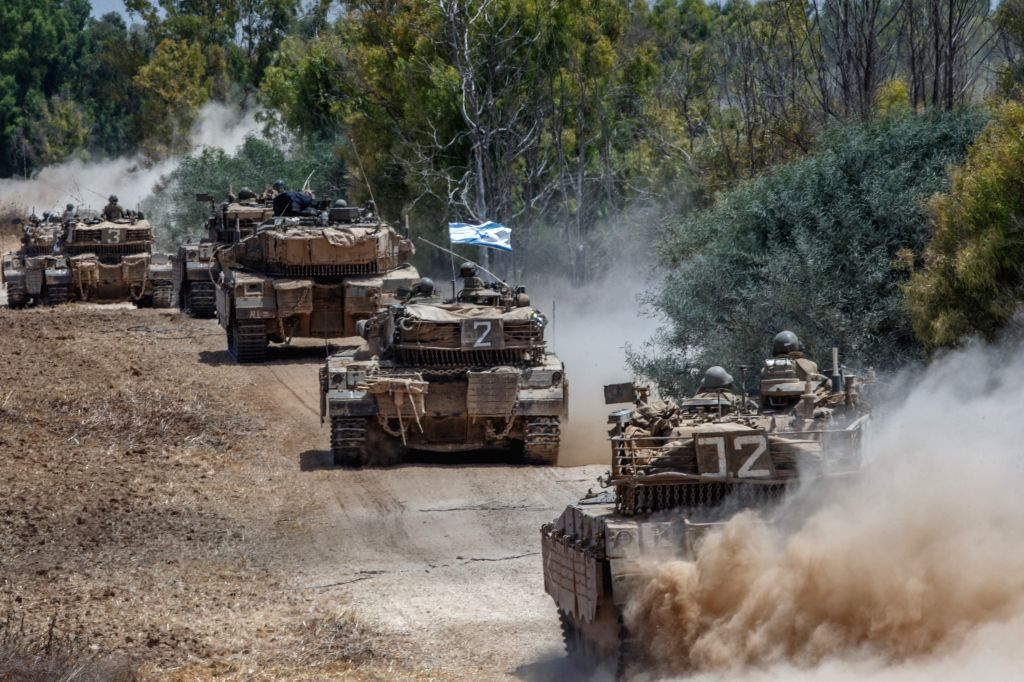 Israeli Markava tanks run in southern Israel near the border with Gaza, on the 11th day of Operation Protective Edge, on July 18, 2014. Israeli Prime Minister .. - Benjamin Netanyahu