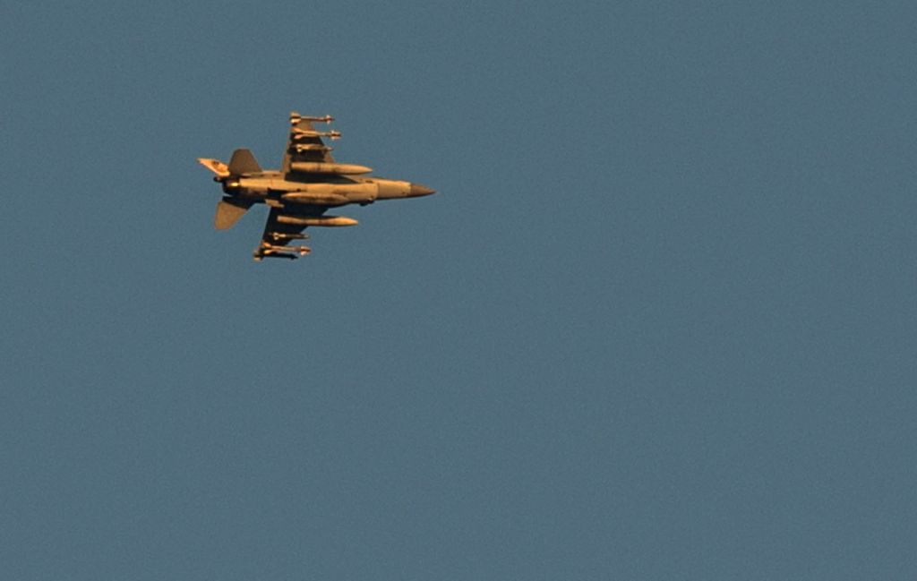 An Israeli Air Force (IAF) aircraft flies over Ashdod, a southern Israeli city bordering the Gaza Strip, on July 22, 2014, the 15th day of Operation Protective .