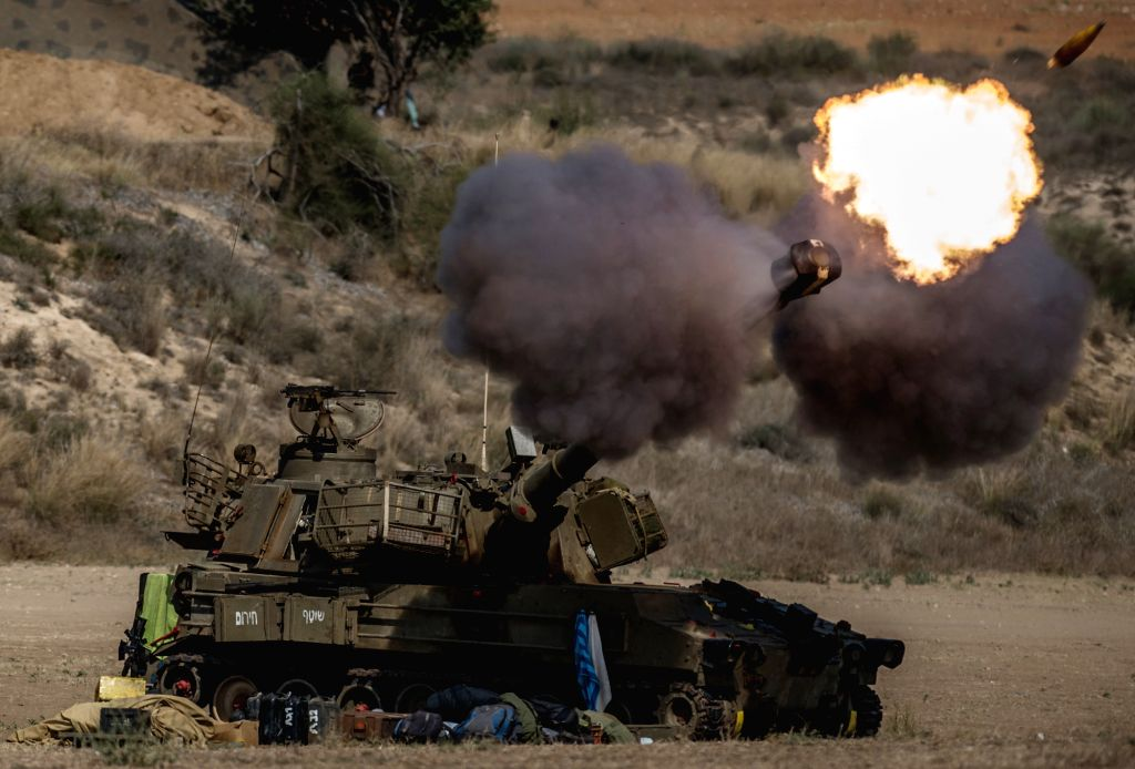 An Israeli self-propelled howitzer fires a shell to the Gaza Strip from southern Israel bordering the Gaza Strip, on July 22, 2014, the 15th day of Operation ...