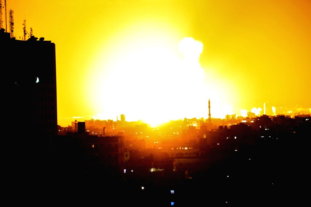 GAZA CITY, Aug. 8, 2018 - An explosion is seen following Israeli air strikes in Gaza City, on Aug. 8, 2018. Israel on Wednesday carried out large-scale air strikes in the Gaza Strip, targeting ...
