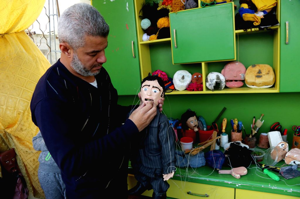 GAZA CITY, Jan. 25, 2019 - Palestinian Mahdi Karira, 39, works inside his house on making of marionette in an attempt to promote the art of puppet theater, in Gaza City, on Jan. 22, 2019. Karira ...
