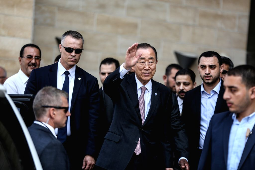 GAZA CITY, June 28, 2016 - United Nations Secretary General Ban Ki-moon (C) waves to the media as he arrives to visit a Qatari-funded rehabilitation and artificial limbs hospital in Gaza City, June ...