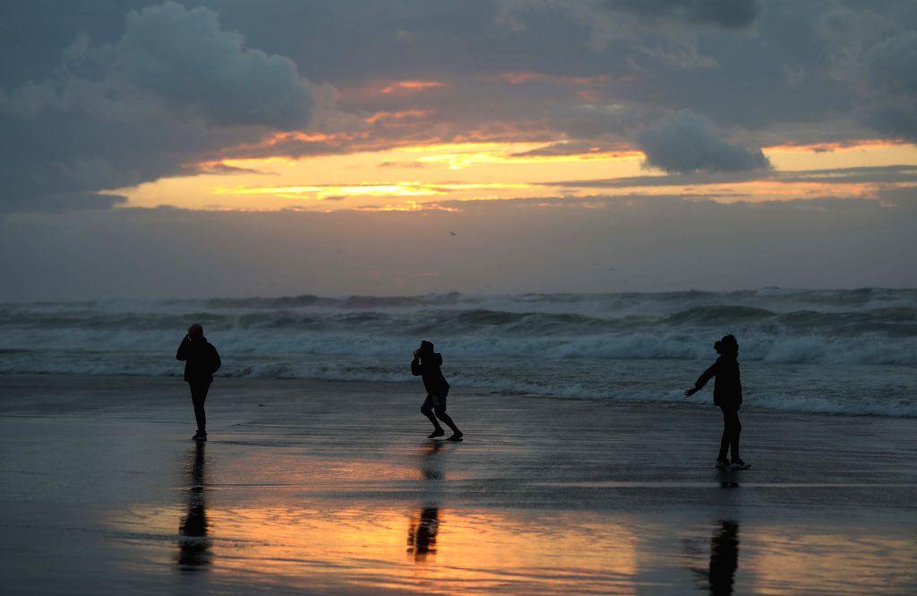 GAZA, Dec. 27, 2019 - Palestinians enjoy their time at a beach in Gaza City, on Dec. 27, 2019.