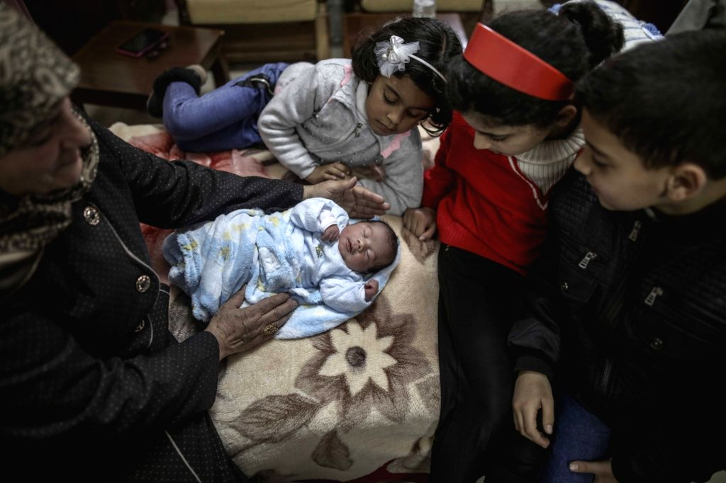 GAZA, Feb. 11, 2018 - Members of a Palestinian family tend a newborn baby inside a hospital in Gaza City, on Feb. 11, 2018. The test-tube baby, named Mujahid, has been born with the smuggled sperm of ...