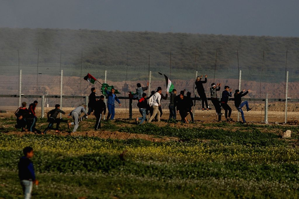 GAZA, Feb. 22, 2019 - Palestinian protesters clash with Israeli troops on the Gaza-Israel border, east of Gaza City, on Feb. 22, 2019. One Palestinian teenager was killed on Friday and dozens injured ...