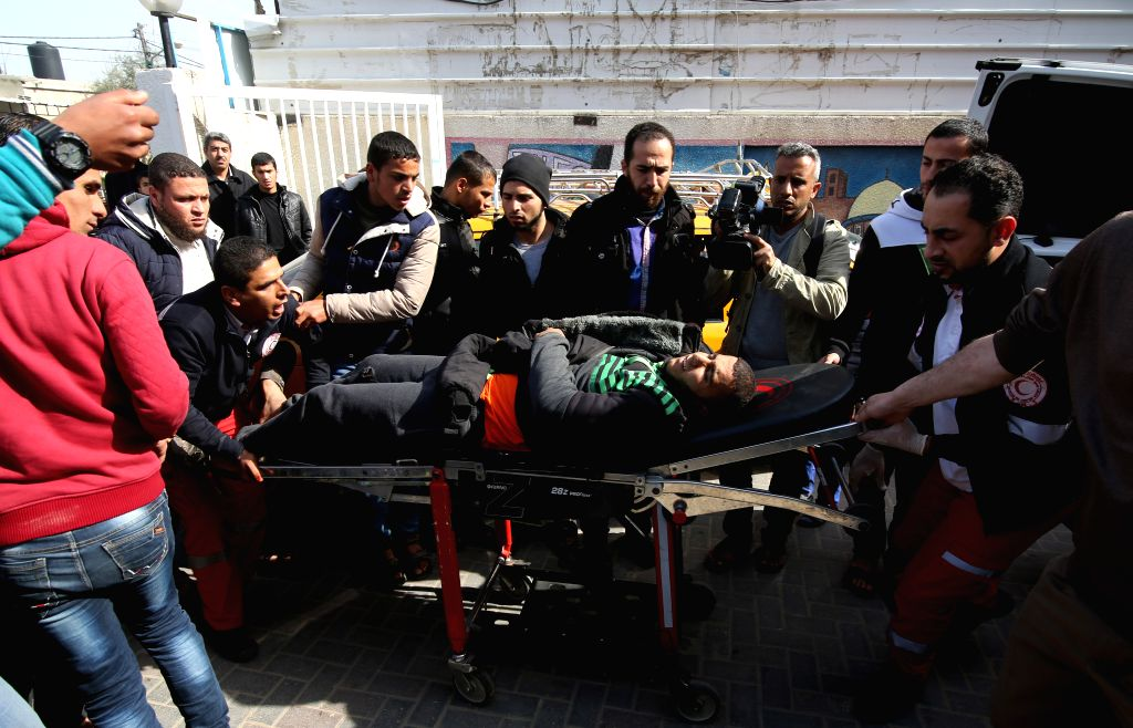 GAZA, Feb. 28, 2017 - People carry a wounded Palestinian to a hospital following an Israeli airstrike in the southern Gaza Strip city of Rafah, on February 27, 2017. Israel's military spokesperson ...