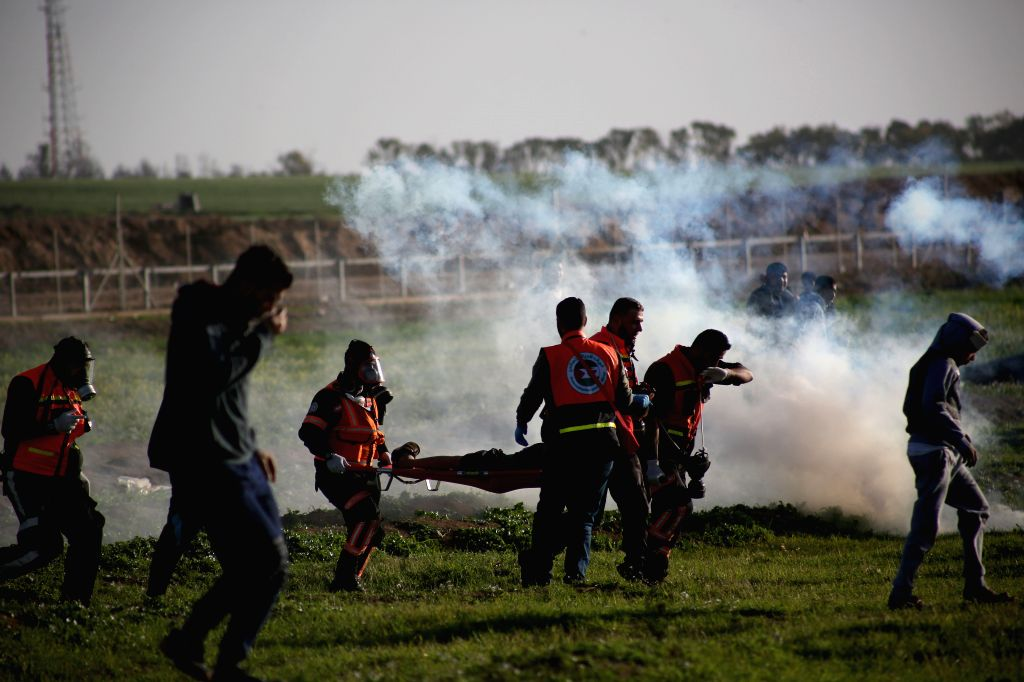 GAZA, Feb. 8, 2019 - Palestinian protesters clash with Israeli troops on the Gaza-Israel border, east of Gaza City, on Feb. 8, 2019. At least two Palestinians were killed and dozens wounded on Friday ...