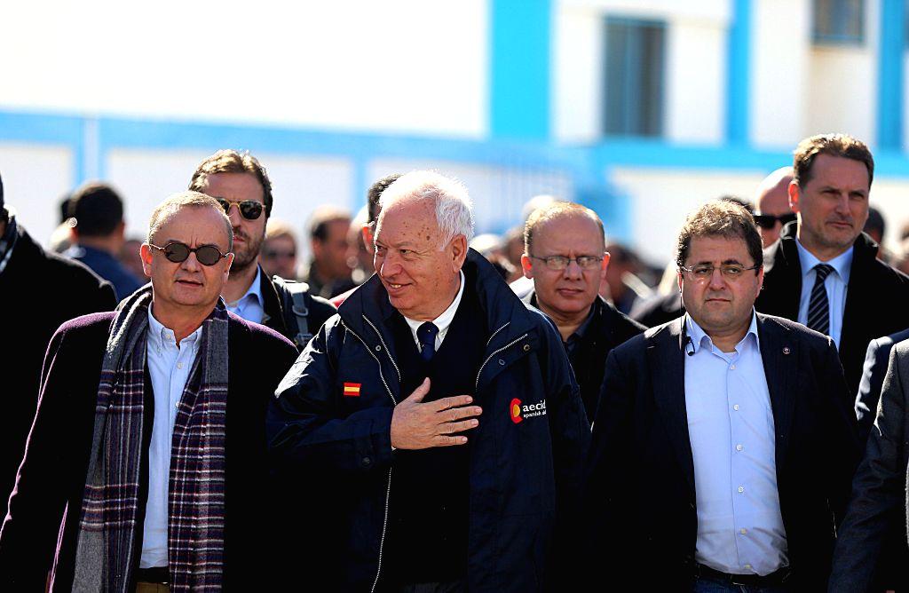 Spanish Foreign Minister Jose Manuel Garcia-Margallo (C) visits a UN-run school in Gaza city, Jan. 13, 2015. Garcia-Margallo visited the Gaza Strip on Tuesday and ... - Jose Manuel Garcia-Margallo