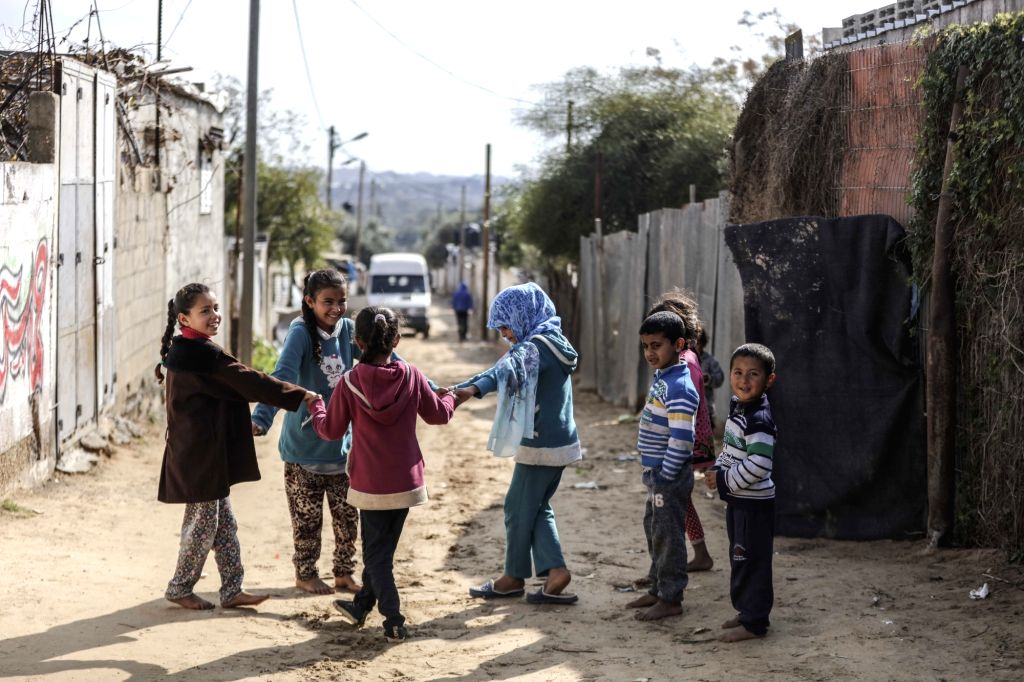 GAZA, Jan. 17, 2018 (Xinhua) -- Palestinian refugee children play at al-Shati refugee camp in Gaza City, on Jan. 17, 2018. The United Nations Relief and Works Agency for Palestine Refugees (UNRWA) said Wednesday that it has launched an international