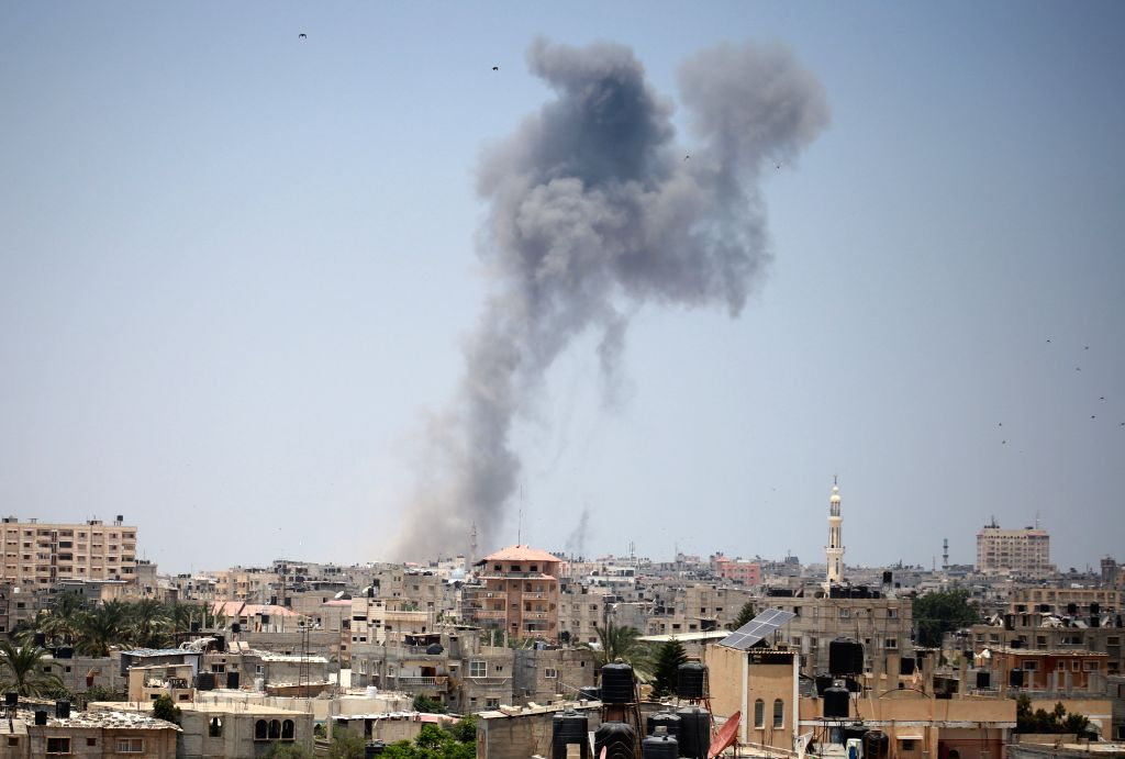 GAZA, July 14, 2018 - An explosion is seen following Israeli strikes in the southern Gaza Strip city of Rafah, near the border with Egypt, on July 14, 2018. The Israeli army said on Saturday that it ...