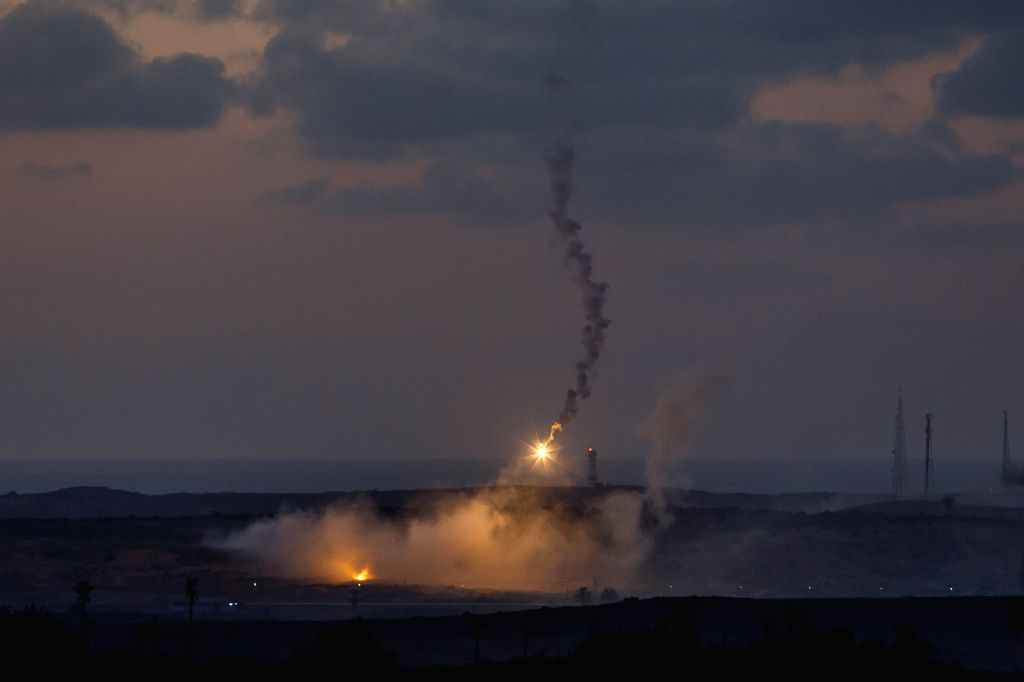 Flares fired by Israeli artilleries are seen in Sderot, an Israeli town near the border with Gaza Strip, July 14, 2014. Israel's security cabinet decided on Tuesday ...