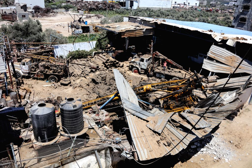 GAZA, July 2, 2016 - Palestinians look at rubbles following an Israeli air strike on a workshop in Gaza City on July 2, 2016. Israeli air strikes hit four sites in the Gaza Strip, causing damage but ...