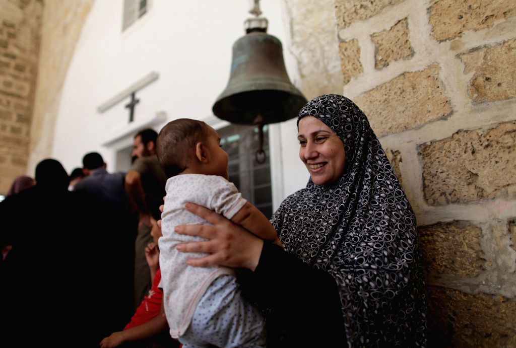 Palestinians fleeing from Israeli airstrikes seek refuge in a Roman Orthodox Church, in Gaza City, July 22, 2014. A total of 70 Palestinians were killed on Tuesday in .