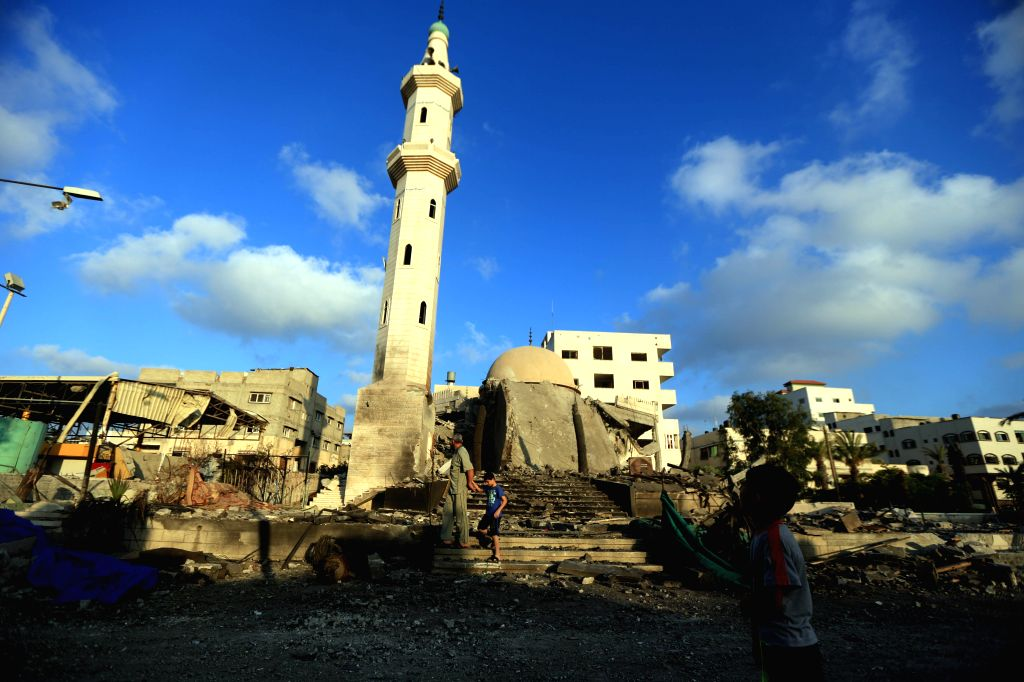 Palestinians inspect a destroyed mosque following an overnight Israeli airstrike July 23, 2014 in Gaza City. The Health Ministry in Gaza said in a press statement that