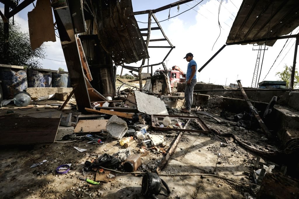 GAZA, July 26, 2018 - A Palestinian man inspects a Hamas observation point targeted by Israeli tank fire near the border with Israel, eastern of Gaza City, on July 26, 2018. Israeli tanks on ...