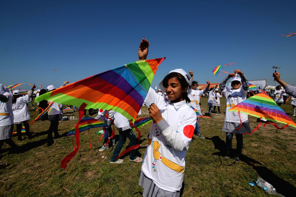 GAZA, March 5, 2017 - Palestinian schoolgirls fly kites during a commemoration organized by the United Nations Relief and Works Agency (UNRWA) to mark the sixth anniversary of Japan's earthquake and ...