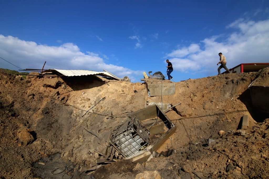 GAZA, March 7, 2019 - Palestinian men check the site of an Israeli airstrike at a seaport under construction in the southern Gaza Strip city of Khan Younis, March 7, 2019. Israeli fighter jets struck ...