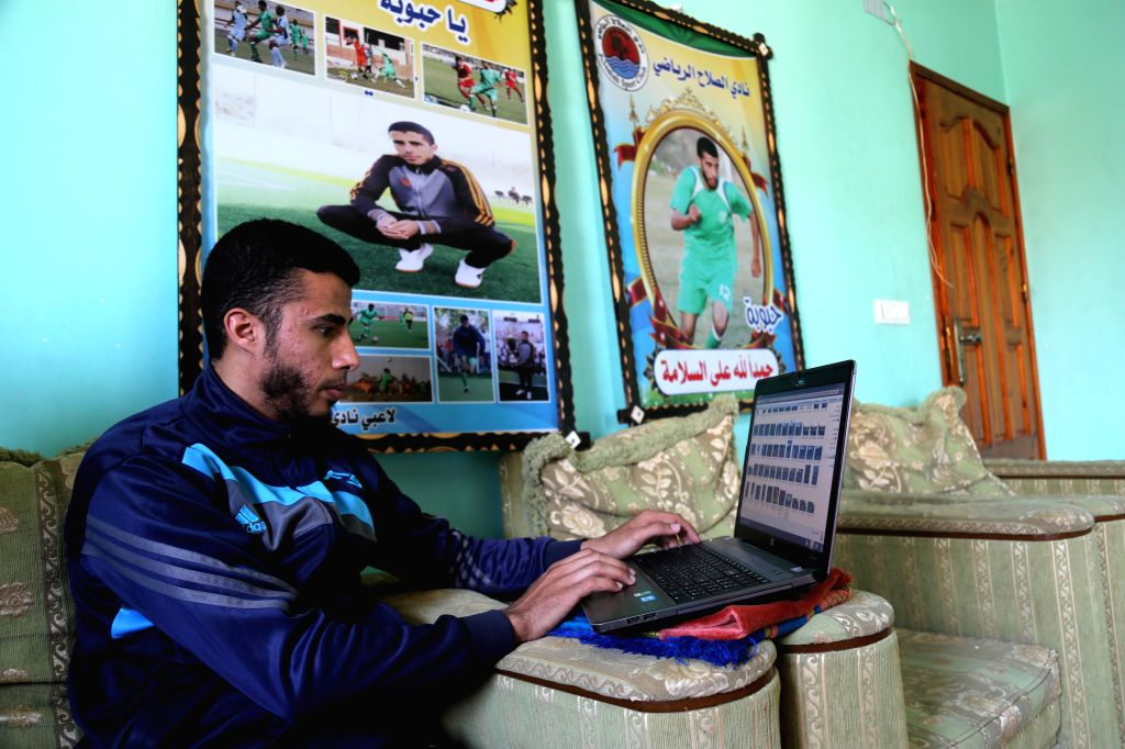 GAZA, March 7, 2019 - Palestinian Mohammed Obeid checks photos and videos of his playing football on the internet inside his house in Deir al-Balah refugee camp in central Gaza Strip, on March 4, ...