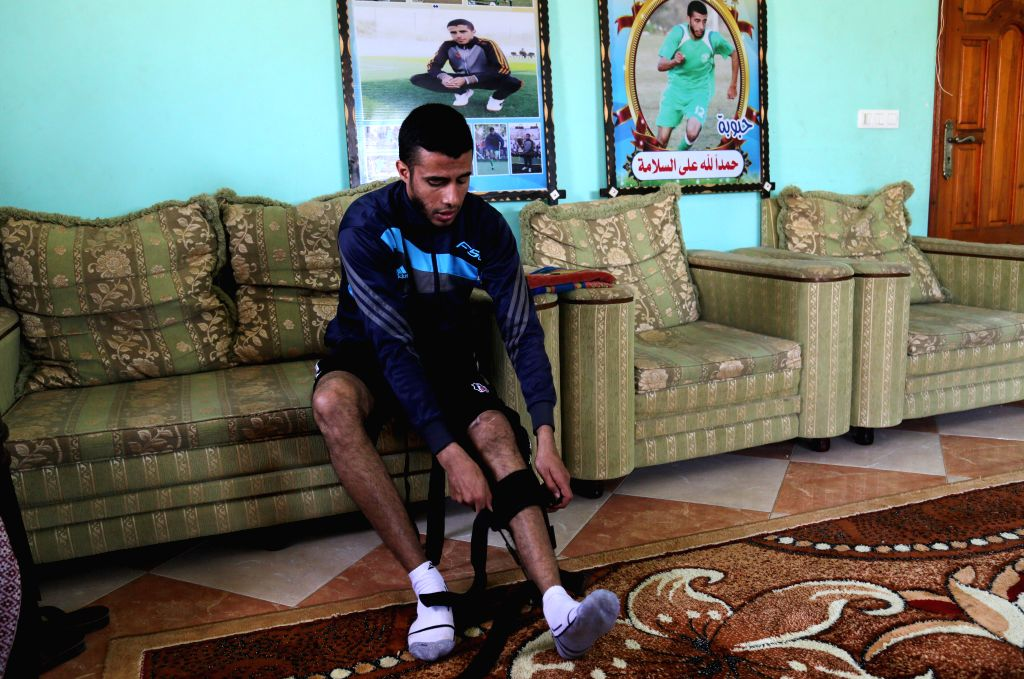 GAZA, March 7, 2019 - Palestinian Mohammed Obeid is seen inside his house in Deir al-Balah refugee camp in central Gaza Strip, on March 4, 2019. An Israeli sniper's gunshot has ended the football ...