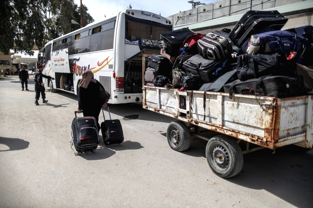 A Palestinian woman, hoping to cross into Egypt, drags her luggages at the Rafah crossing point between Egypt and the southern Gaza Strip, March 9, 2015. Egypt on ...