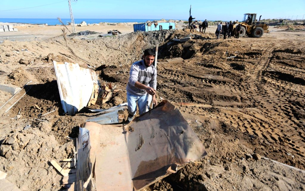GAZA, March 9, 2019 - A Palestinian checks the site of an Israeli airstrike at a seaport under construction in the southern Gaza Strip city of Khan Younis, March 9, 2019. Israeli war jets on Friday ...
