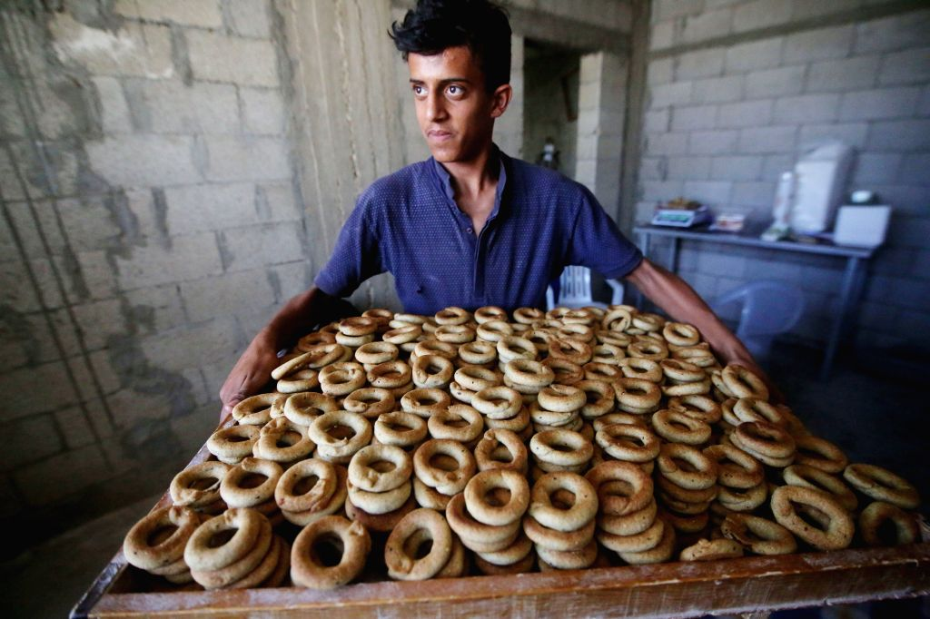 GAZA, May 28, 2019 - A Palestinian young man prepares traditional cookies ahead of the Eid al-Fitr festivities in celebrating the end of the holy Muslim fasting month of Ramadan, in the southern Gaza ...