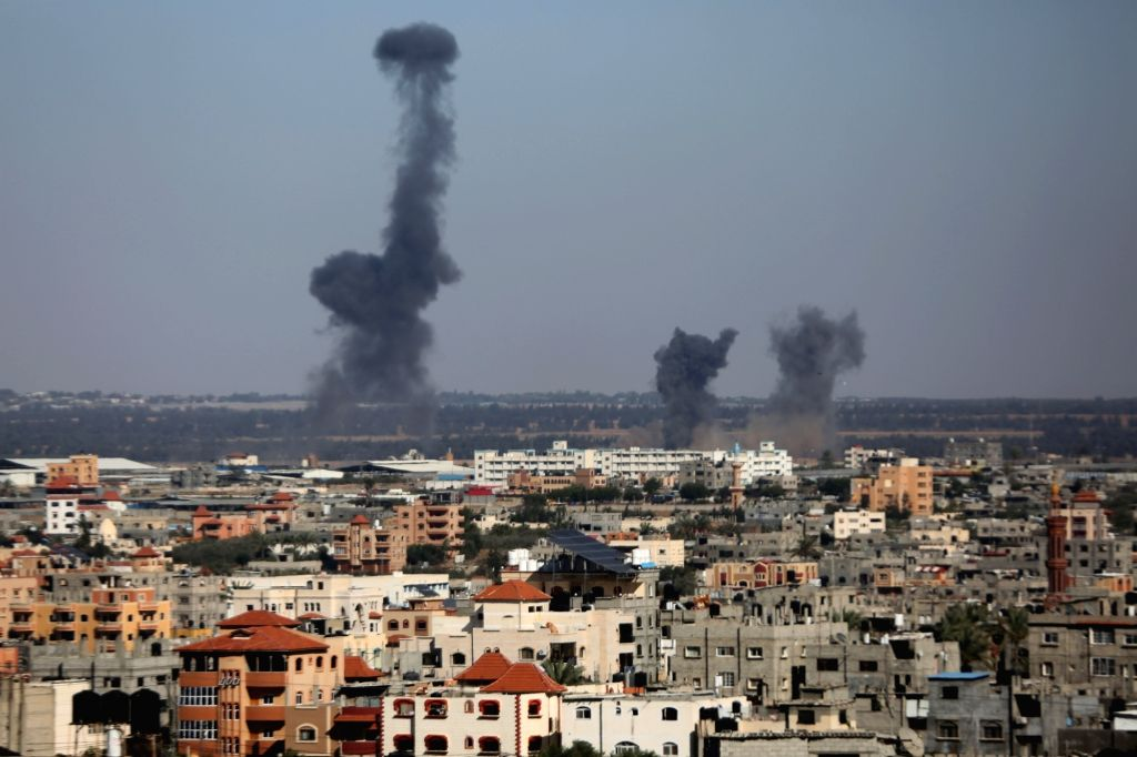 GAZA, May 4, 2019 - Smokes and flames rise after an Israeli airstrike in Gaza, May 4, 2019. Israeli army warplanes, drones and artillery continued on Saturday afternoon striking on militants ...