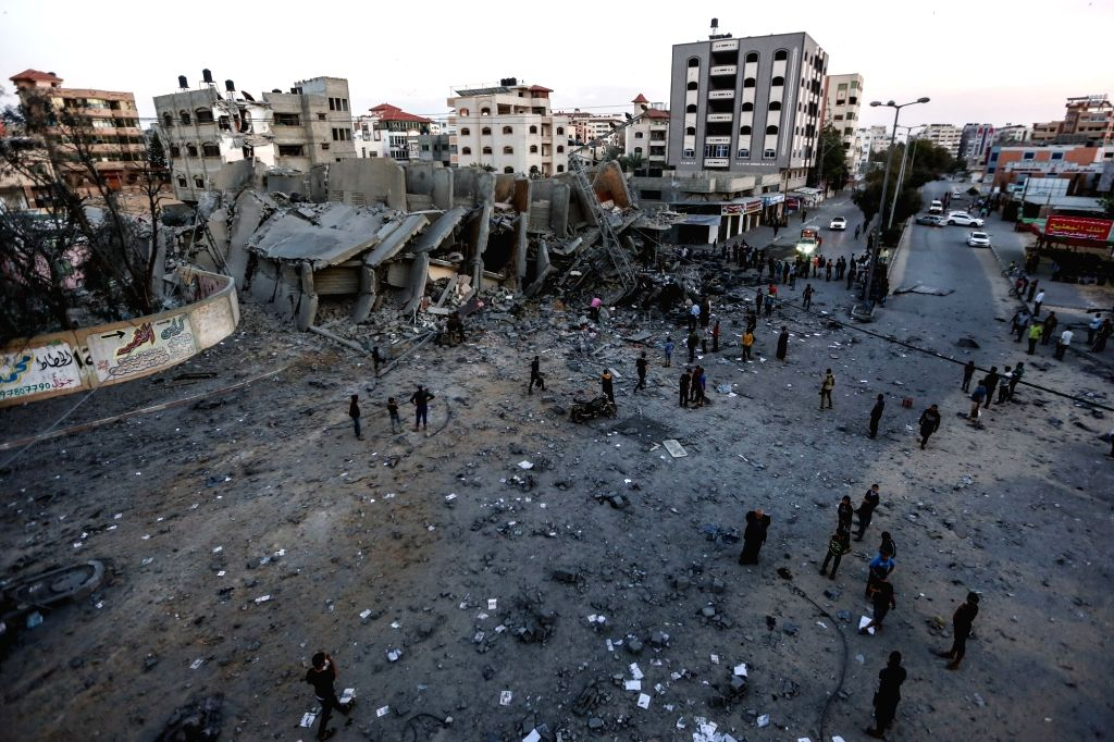 GAZA, May 5, 2019 - Palestinians inspect the remains of a building that was destroyed during Israeli airstrikes on Gaza City, on May 5, 2019. At least 20 Palestinians, including two infants and two ...