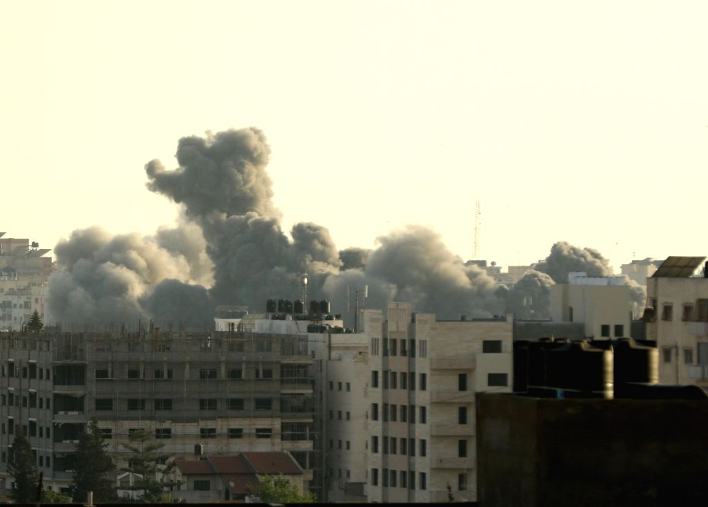 GAZA, May 5, 2019 - Smoke rises during an Israeli airstrike on Gaza City, on May 5, 2019. At least 20 Palestinians, including two infants and two pregnant women, have been killed in intensive Israeli ...