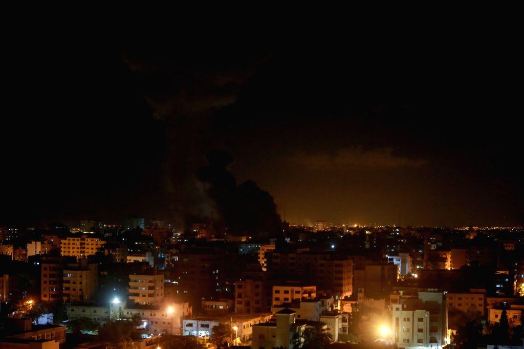 GAZA, Nov. 12, 2018 (Xinhua) -- Photo taken on Nov. 12, 2018 shows smoke rising following an Israeli airstrike on Hamas-run television station Al-Aqsa Television in Gaza City. Israeli war jets struck with eight missiles on Monday night the building o