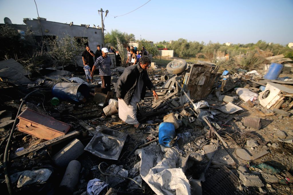 GAZA, Nov. 14, 2019 - Palestinians inspect the damaged house destroyed in an Israeli air strike, in Deir al-Balah, central of Gaza Strip, Nov. 14, 2019. Six Palestinians were killed in the central ...