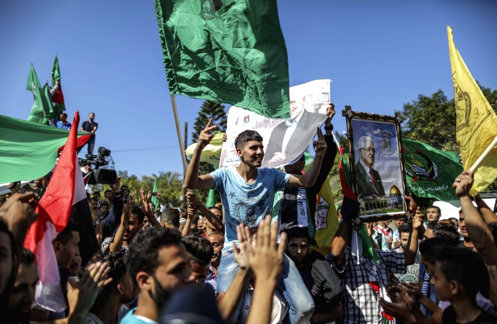 GAZA, Oct. 12, 2017 - Palestinians celebrate after Palestinian rival movements Hamas and Fatah signed a reconciliation agreement following talks mediated by Egypt, in Gaza City, on Oct. 12, 2017. ...