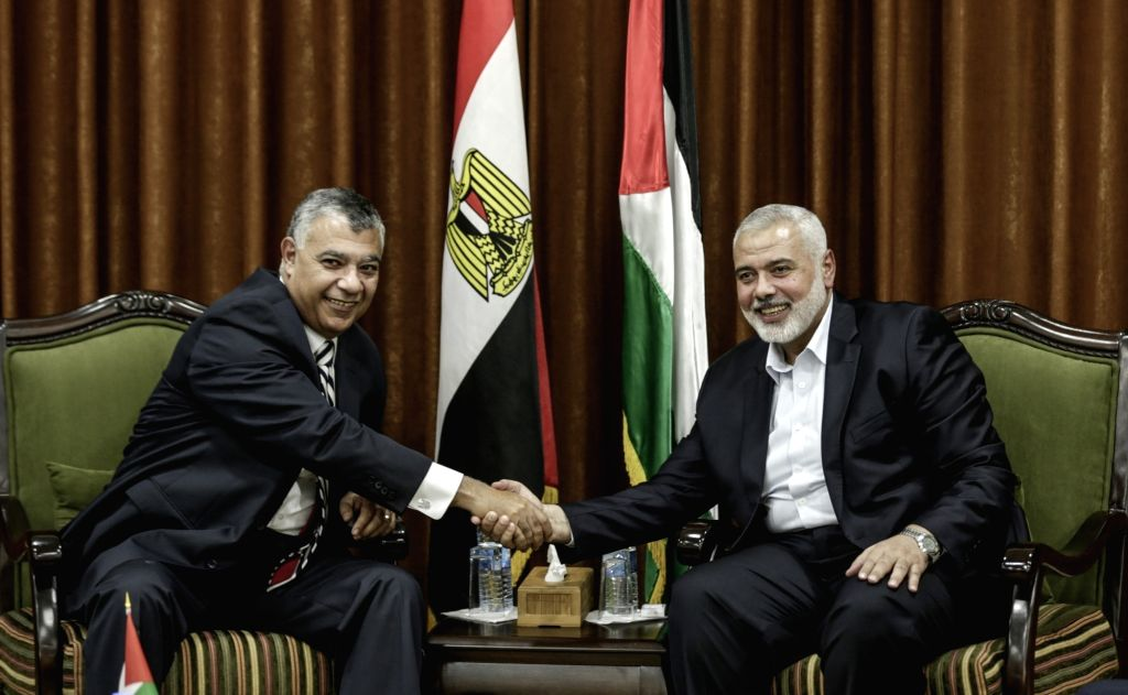 GAZA, Oct. 3, 2017 - Islamic Hamas movement chief Ismail Haniyeh (R) shakes hands with the chief of Egyptian intelligence Khaled Fawzi during their meeting in Gaza City, on Oct. 3, 2017. Islamic ...