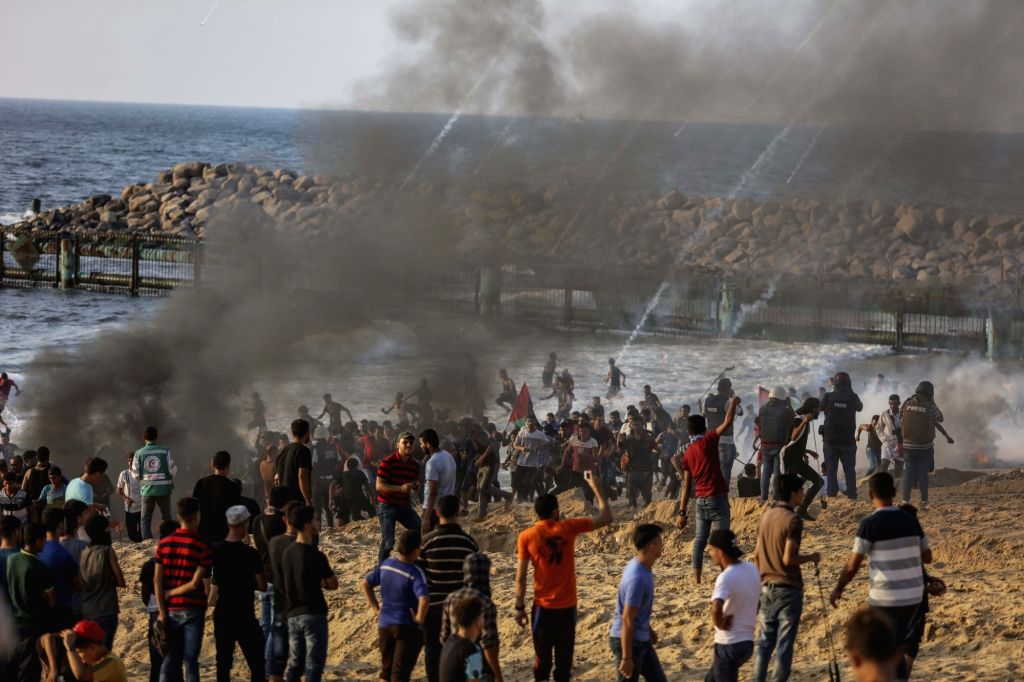 GAZA, Sept. 11, 2018 - Palestinian protesters take part in clashes with Israeli troops on a beach near the maritime border with Israel, in the northern Gaza Strip, on Sept. 10, 2018.
