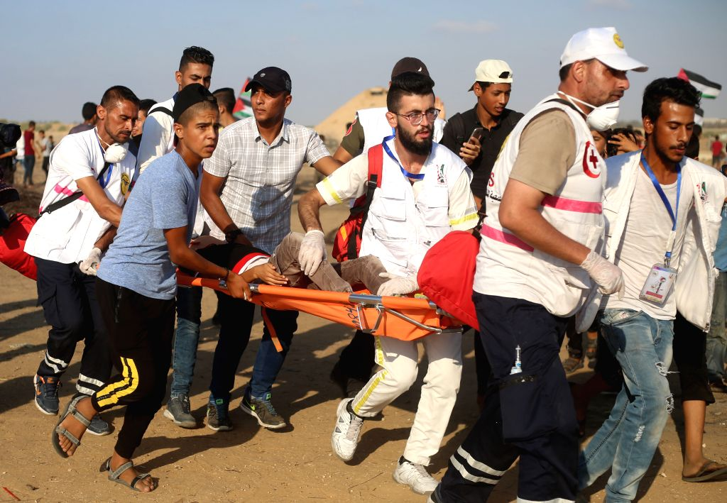 GAZA, Sept. 14, 2019 - Palestinian medics carry a boy wounded in clashes with Israeli troops on the border with Israel, in east of southern Gaza Strip city of Khan Younis, Sept. 13, 2019.