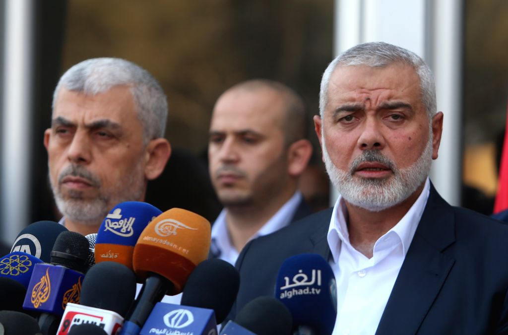 GAZA, Sept. 19, 2017 - Hamas Chief Ismail Haniyeh (R) attends a news conference on his return from Egypt at Rafah border crossing in the southern Gaza Strip, Sept. 19, 2017. Haniyeh said on Tuesday ...