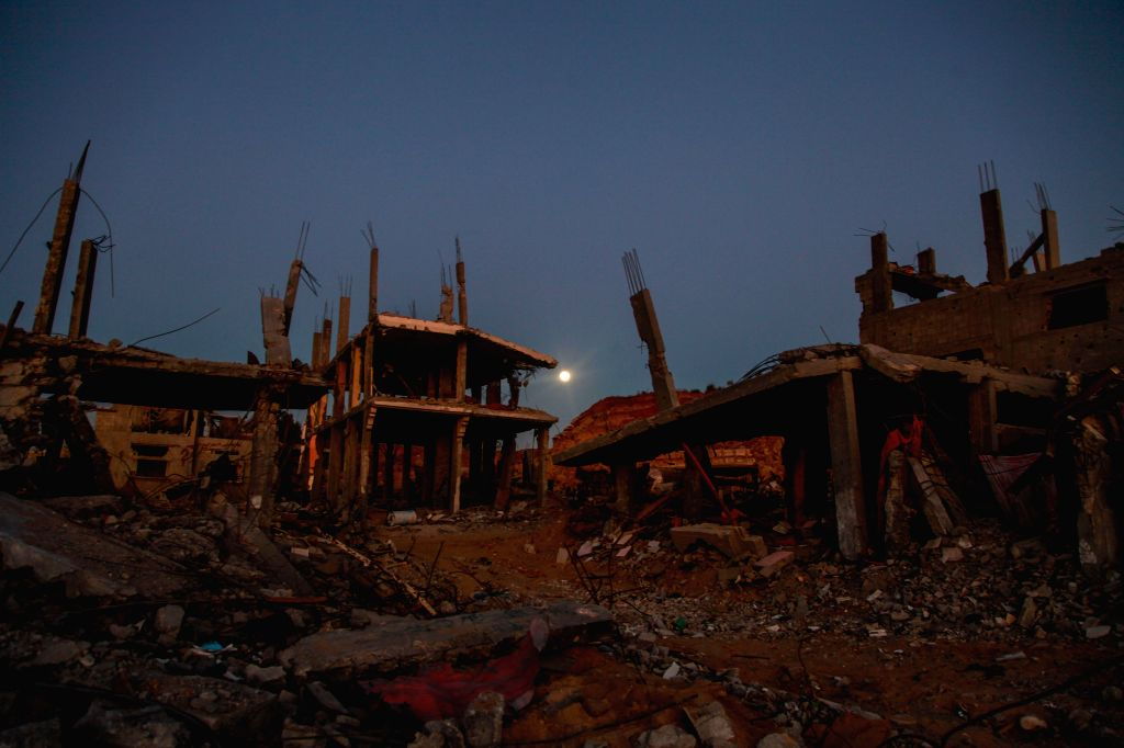 GAZA, Sept. 2014 Rubbles of destroyed houses are seen under a full moon in Gaza City, on Sept 8, 2014, .