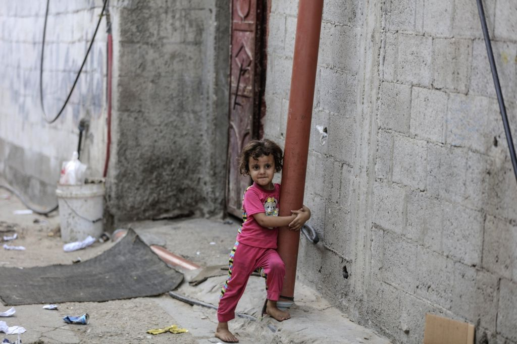 GAZA, Sept. 3, 2018 - A Palestinian girl plays outside her home in the Shati refugee camp in Gaza City, on Sept. 2, 2018. Palestinian President Mahmoud Abbas said Sunday that the question of the ...