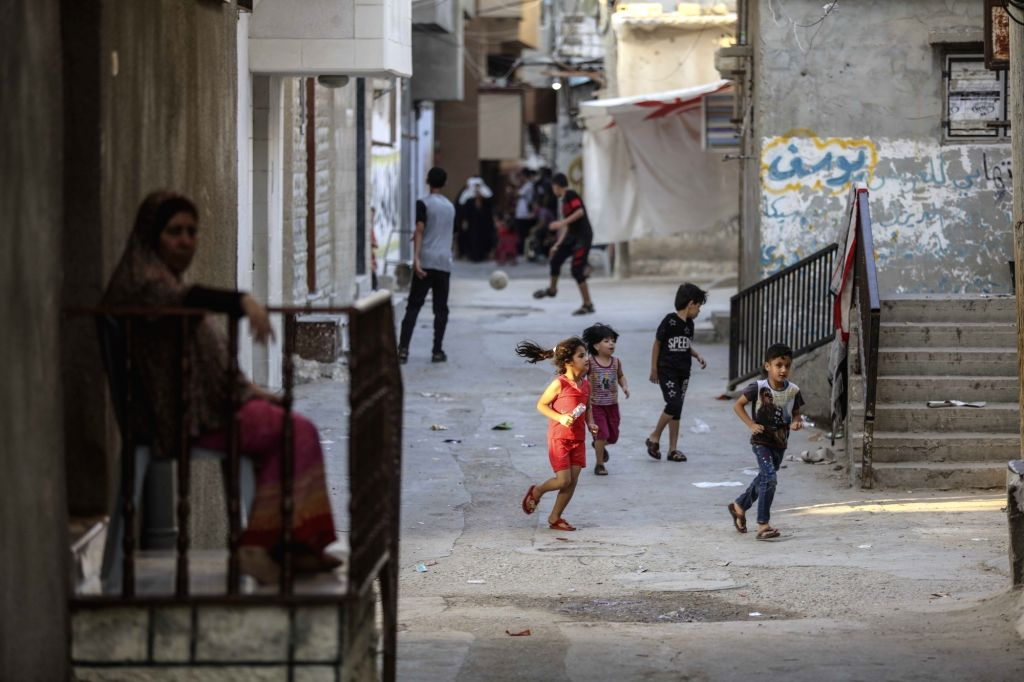GAZA, Sept. 3, 2018 - Palestinian children play outside their home in the Shati refugee camp in Gaza City, on Sept. 2, 2018. Palestinian President Mahmoud Abbas said Sunday that the question of the ...
