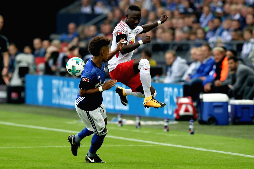 GELSENKIRCHEN, Aug. 20, 2017 - Schalke's Thilo Kehrer (L) and Leipzig?s Naby Keita  vie for the ball during the German First division Bundesliga football match between FC Schalke 04 and RB Leipzig in ...