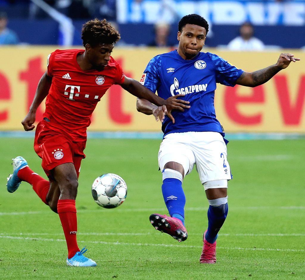 GELSENKIRCHEN, Aug. 25, 2019 - Kingsley Coman (L) of Munich vies with Weston McKennie of Schalke 04 during the Bundesliga soccer match between FC Bayern Munich and FC Schalke 04 in Gelsenkirchen, ...