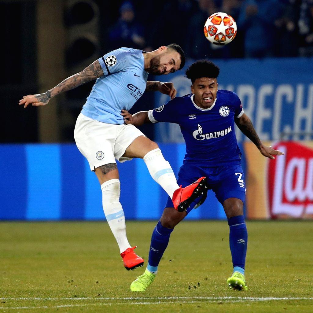 GELSENKIRCHEN, Feb. 21, 2019 - Bernardo Silva (L) of Manchester City vies with Weston McKennie of Schalke 04 during the UEFA Champions League round of 16 first leg soccer match in Gelsenkirchen, ...