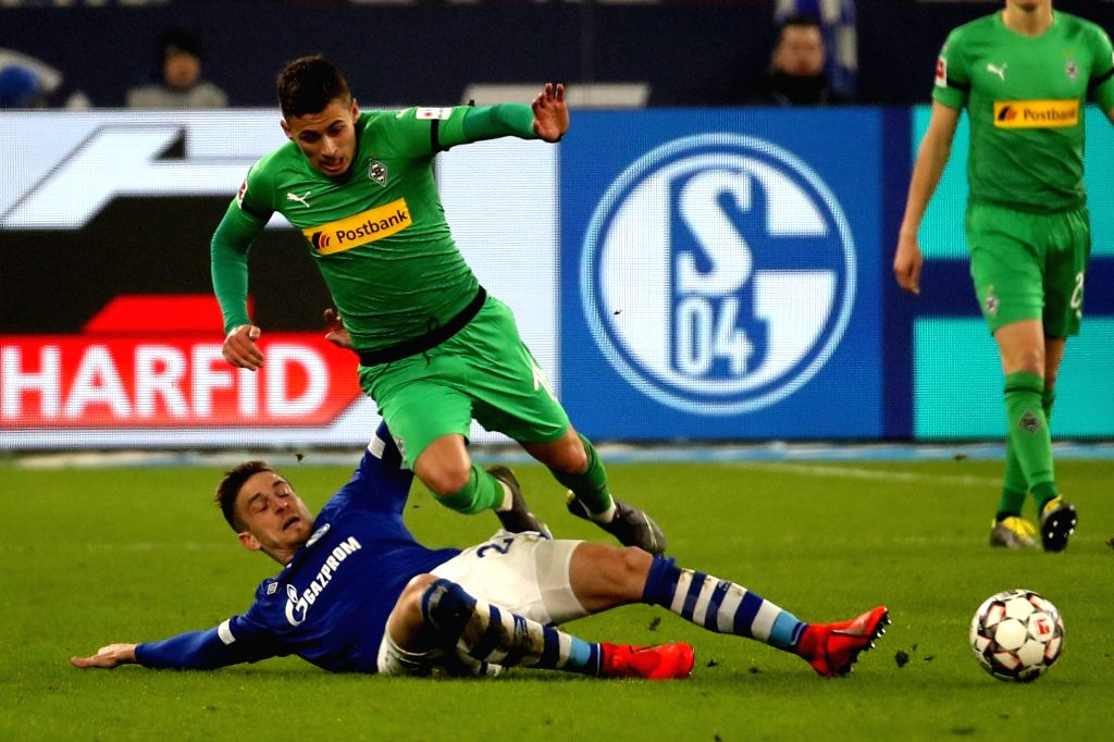 GELSENKIRCHEN, Feb. 3, 2019 - Bastian Oczipka (L) of Schalke 04 vies with Thorgan Hazard of Moenchengladbach during the Bundesliga match between FC Schalke 04 and Borussia Moenchengladbach in ...