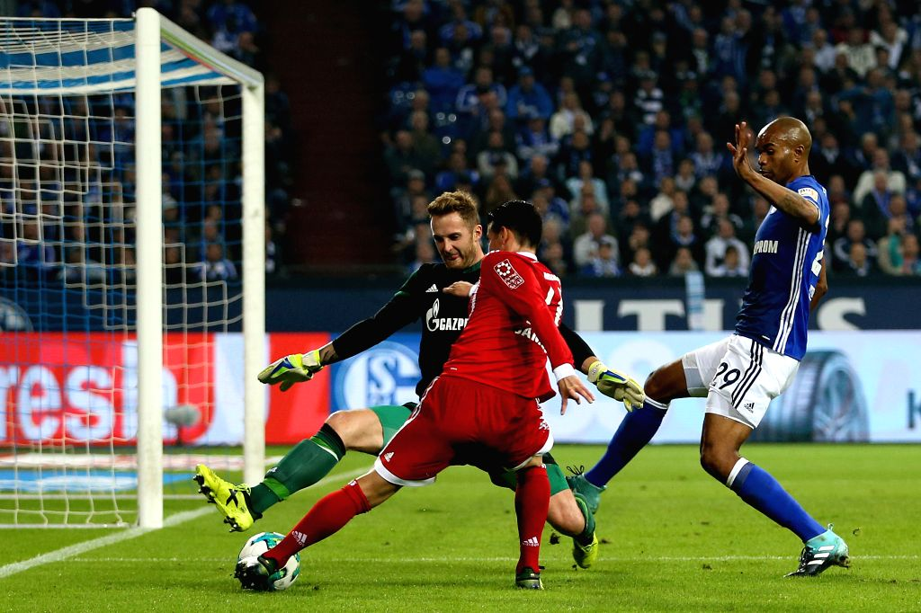 GELSENKIRCHEN, Sept. 20, 2017 - James Rodriguez (C) of Bayern Munich vies for the ball during the German Bundesliga match between Schalke 04 and Bayern Munich in Gelsenkirchen, Germany, on Sept. 19, ...